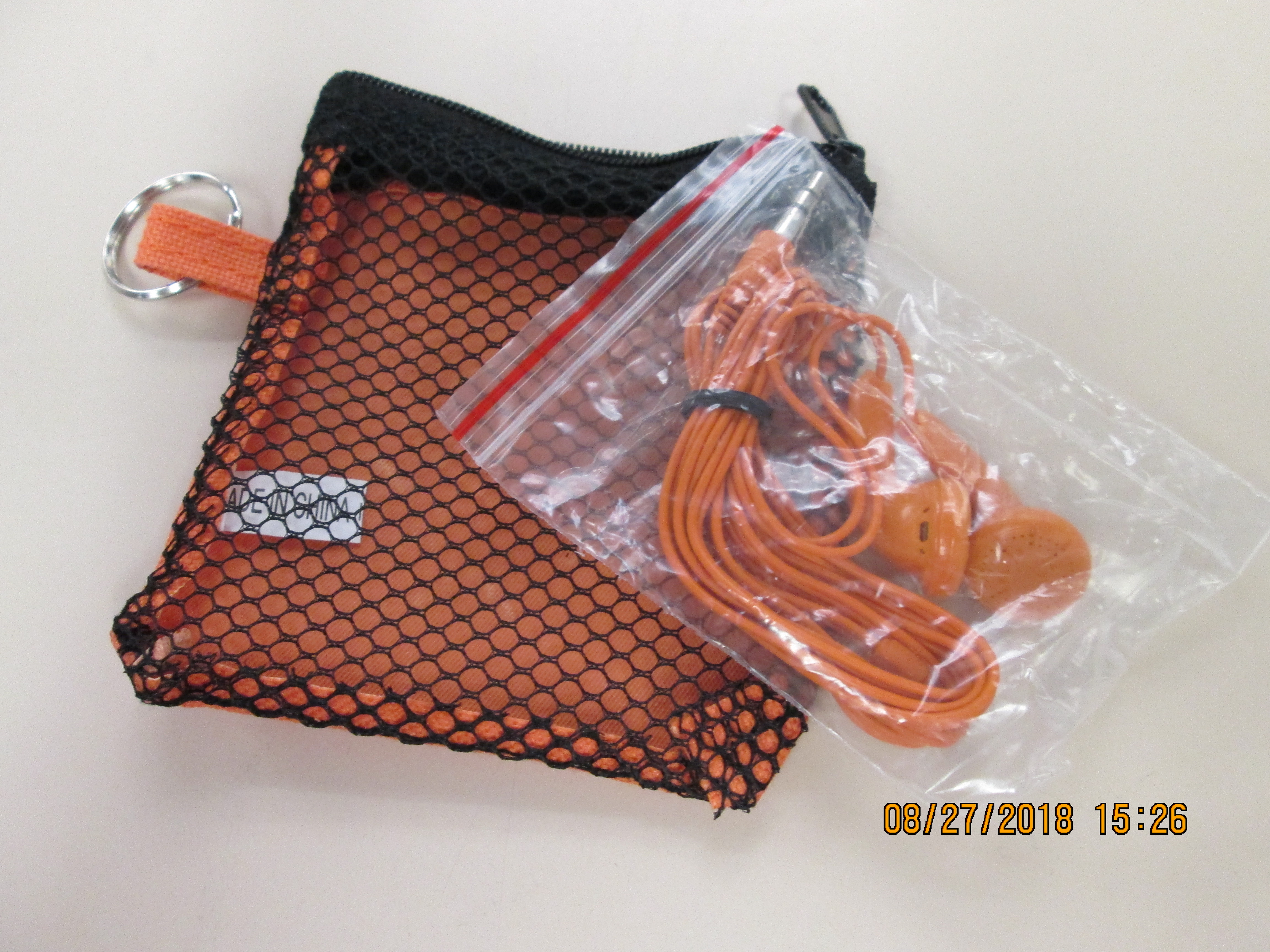 Orange Earbuds with Small Mesh Bag