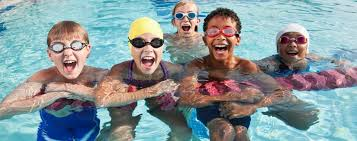 Five Children Wearing Goggles Floating and Smiling in the Water